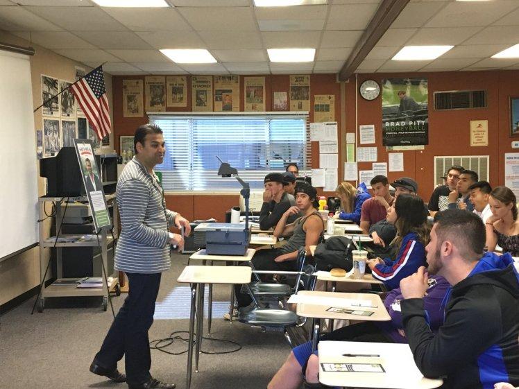 Shamus speaking to students at Ramona High School